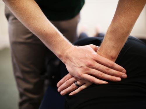 Chiropractor Tooele UT Marty Rueckert Adjusting His Patient